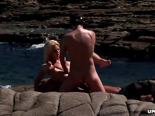 Blonde enjoys double penetration by big cocks on the beach