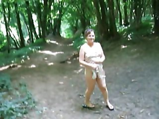 Small Titted Milf Suzy Flashing in the woods.