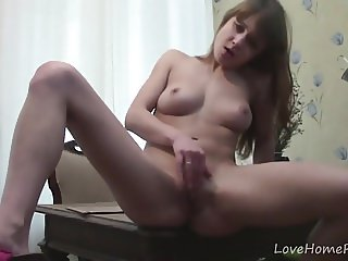 Brunette with big tits loves spreading her legs