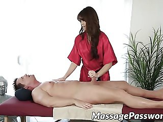 Sexy brunette gives a guy hot massage