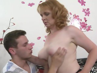 Busty brunette mature gets fucked by a young guy