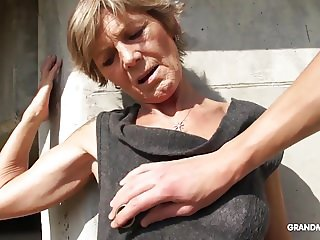 Hot tattooed grandma enjoys giving blowjob