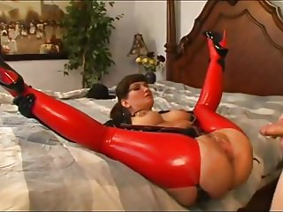 MILF in Black Latex Top and Red Thigh Boots Sucks and Fucks