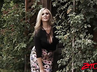 Big titted milf Julia Ann teases before riding stiff rod