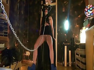 Dark witch in a BDSM scene