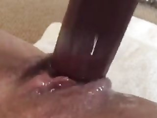 Fucking a juicy creamy pussy with a dildo
