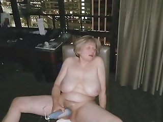 Mature masturbation in front of open hotel window