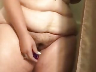 Young BBW masturbates in the shower