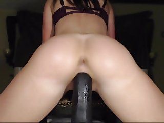 Amazing fit booty riding huge black dildo