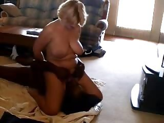 Cuckold films his mature wife playing with a black bull