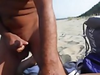 Strangers on a beach cum in wife