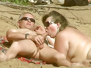 Sex on the beach. Blowjob on the beach