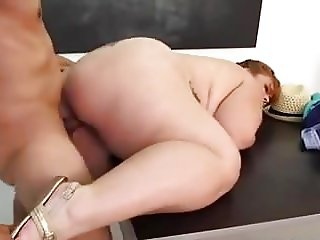 Chubby slut fucked on the desk