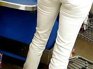 Candid skinny MILF in white jeans with VPL