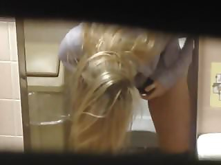 Blonde hovering over toilet, hidden cam