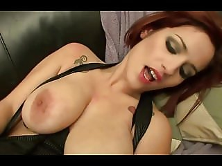 Redhead whipping out her big natural tits