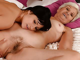 Gray GILF and her younger pussy addict friend
