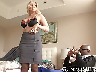 Big breasted MILF invites a stallion for interracial plowing