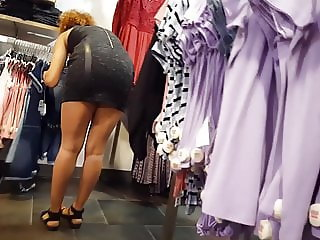 Candid voyeur hot mall employee in tight dress