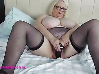 Granny fucks her old pussy