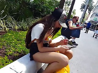Candid voyeur hot teen sitting playing on phone