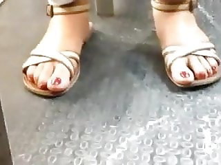 young latina big red toes on sandals