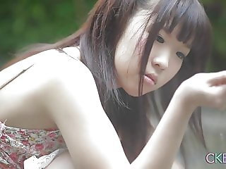 Shy Japanese teen Uri-chan playing by the water