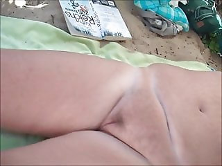 mature licking pussy on beach