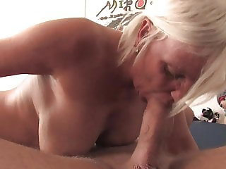Mature blonde has fun with cock