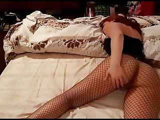 Big bottom spanking in corset and fishnet stockings