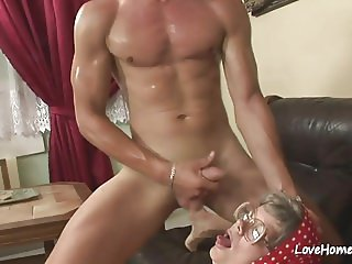 Granny with glasses is eager to taste him.mp4