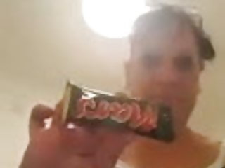 Eating Mars bar with pussy