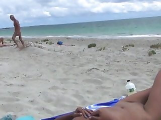 Young asian girl having sex on a nude beach with three man