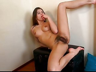 Thin brunette girl with hairy cunt is masturbating
