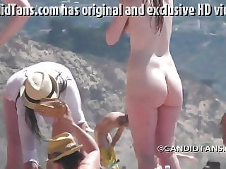 Big butt blonde on the beach with friends naked!