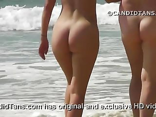 Cute beach babe naked walking in public showing pussy!