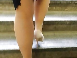 Sexy legs in lace top stockings and pumps on stairs