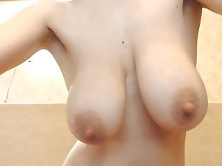 She shows big nipples and moans