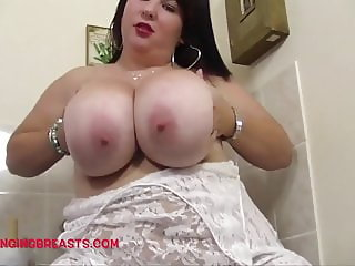 Young babe kisses and sucks her huge juggs
