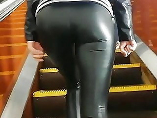 TEEN ON STAIRS IN LEATHER LEGGINGS
