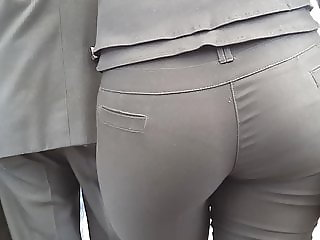 Milf in tight pants waiting bus