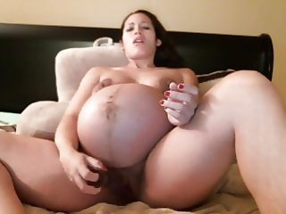 9 month pregnant horny girl playing with her dildo