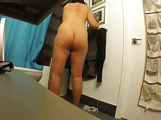 Asian milf shows big nipples and meaty ass in bathroom