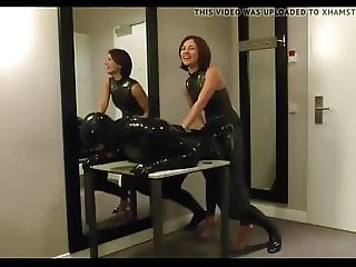 Strapon Latex with two Mistress