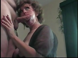 Cougar wife on her knees sucking my friends cock.