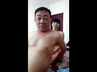 Asian daddy with younger woman
