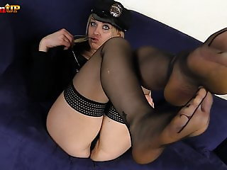 Blonde police woman in stockings masturbates and shows feet