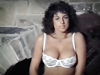 SLAVE TO THE NIGHT - vintage big boobed beauty strip dance