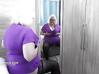 Mature Sally playing in the mirror