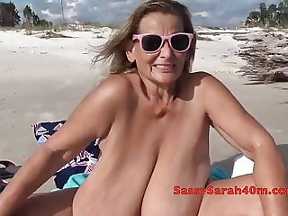 Mature flaunts her tits at the seaside